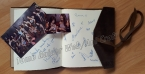 Tomb Raider Event Diary, signed by Alicia Vikander and all attending cosplayers - Property of Ani Croft
